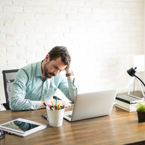 Stressed business owner dealing with burnout from running their small business