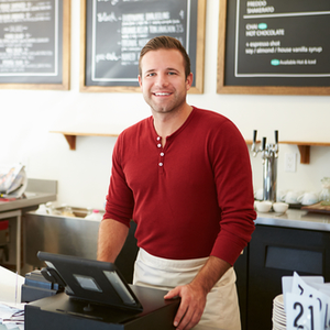 Small business owner working at coffee shop and preparing to file W2 Form 2018